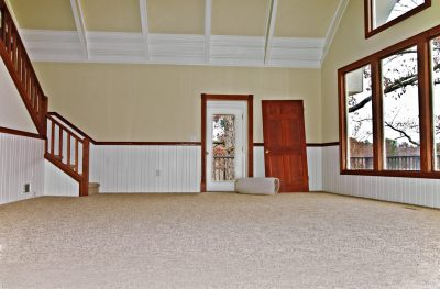 Newly installed carpet in a large room.